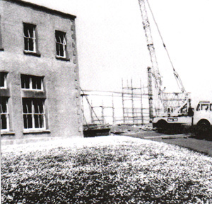 The new one story block in progress 1970